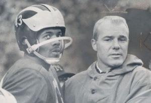 Coach Bump Elliott and All-American halfback Bennie McCrae